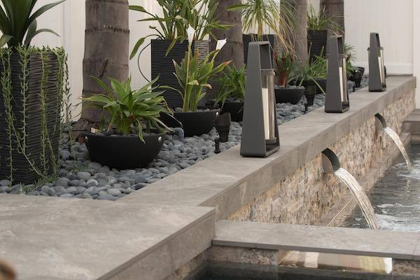 pairing pavers with pebbles for your perfect outdoor oasis