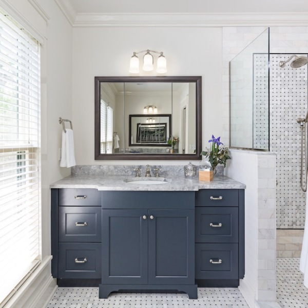 honed bathroom with marble tile