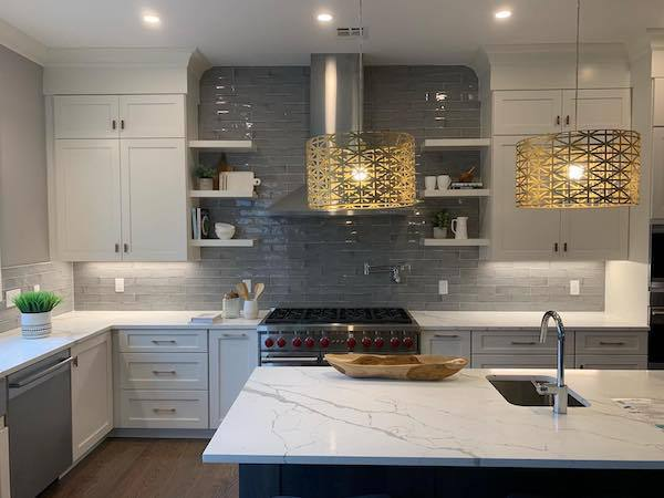 marble look counter with glass tile backsplash