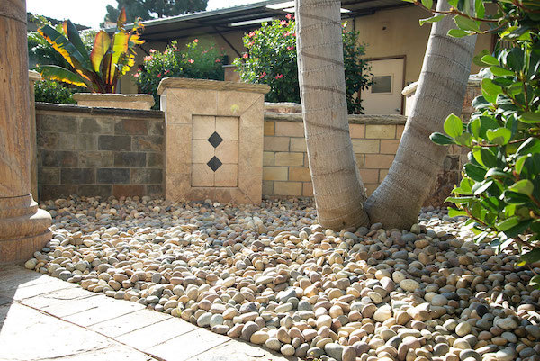 outdoor oasis with pebbles