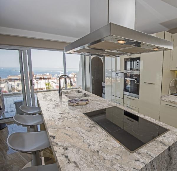 white and taupe granite in loft kitchen