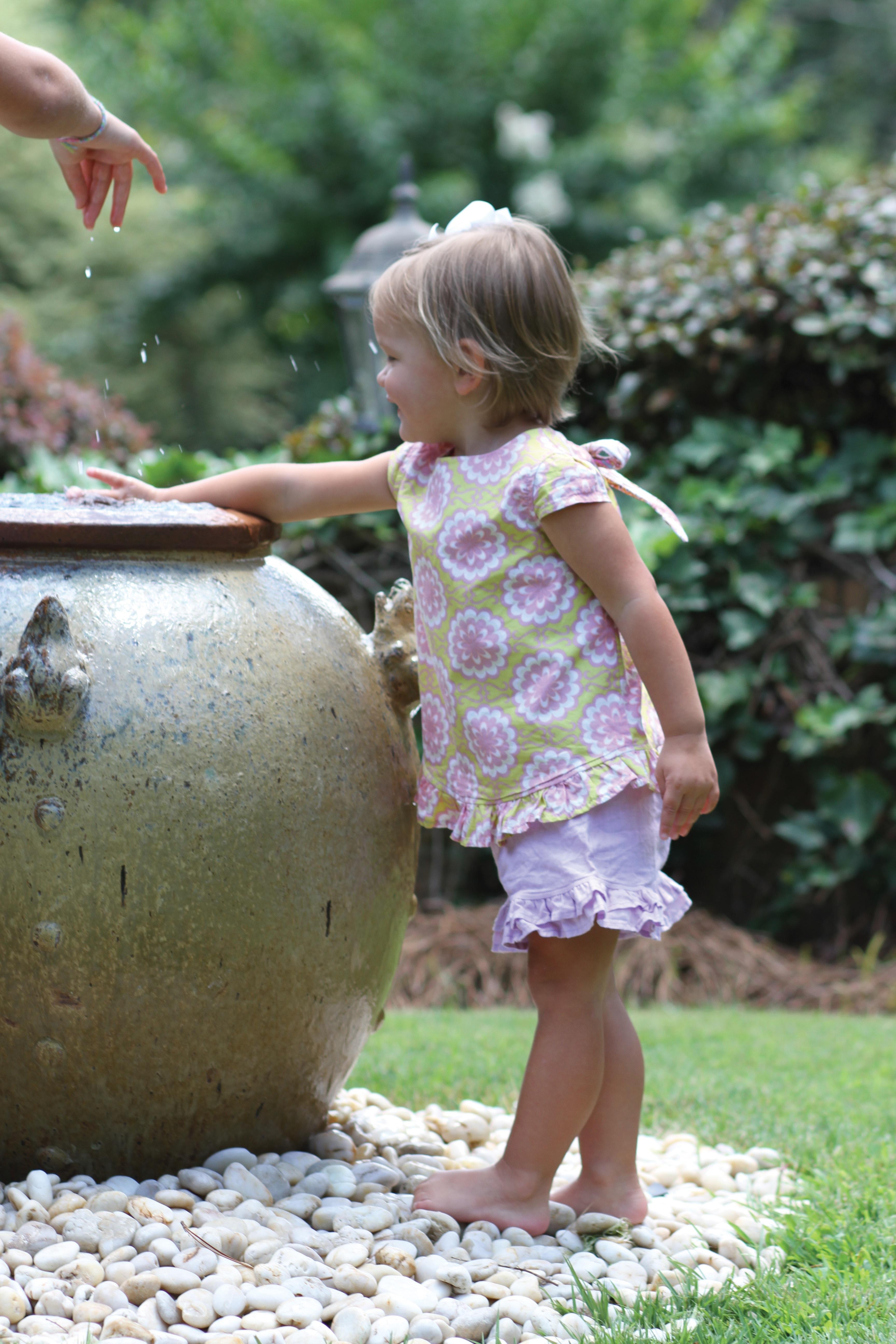 white pebble stone garden with child