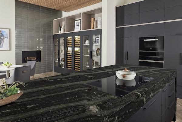 black countertop island in contemporary kitchen