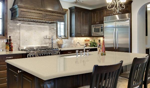 creamy quartz countertop in warm kitchen