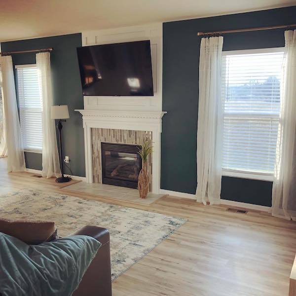 lvt flooring in light wood in living room with fireplace