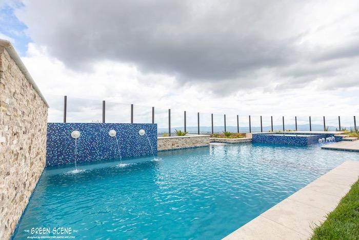 golden honey stacked stone ledgers surrounding pool