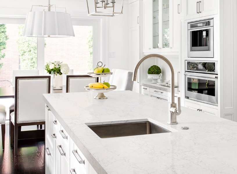 marble look quartz with delicate veining in white kitchen