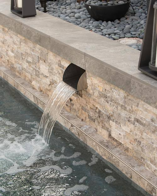 silver travertine water feature with stacked stone