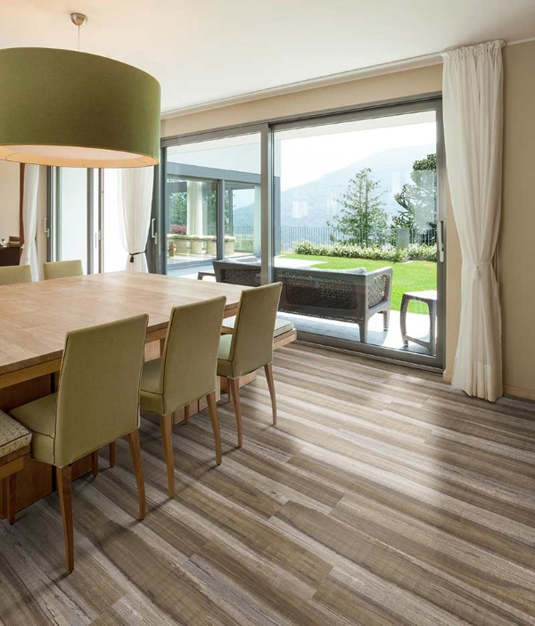 multi colored natural wood flooring in dining room