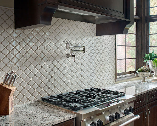 alaska white granite kitcken counter with beautiful backsplash tile