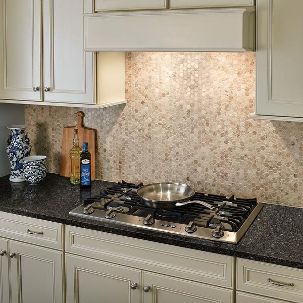 dark granite countertop with cream colored cabinets