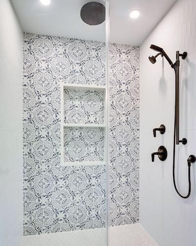 porcelain tile floral pattern in denim shower surround