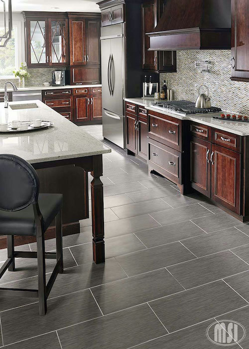 white granite with colorful tile backsplash