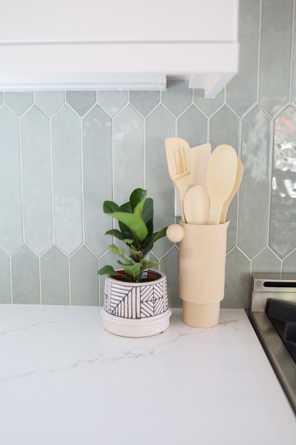 msi-renzo-jade-pickett-backsplash-kitchen-tile-close-up-with-plant-and-wooden-spoons