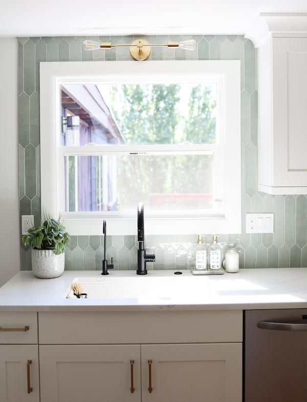 msi-renzo-jade-pickett-jade-backsplash-above-kitchen-sink-with-bright-window