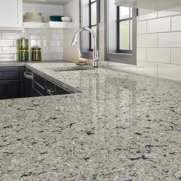 msi-antico-cloud-quartz-grey-and-tan-veined-countertop-with-white-subway-tile-backsplash