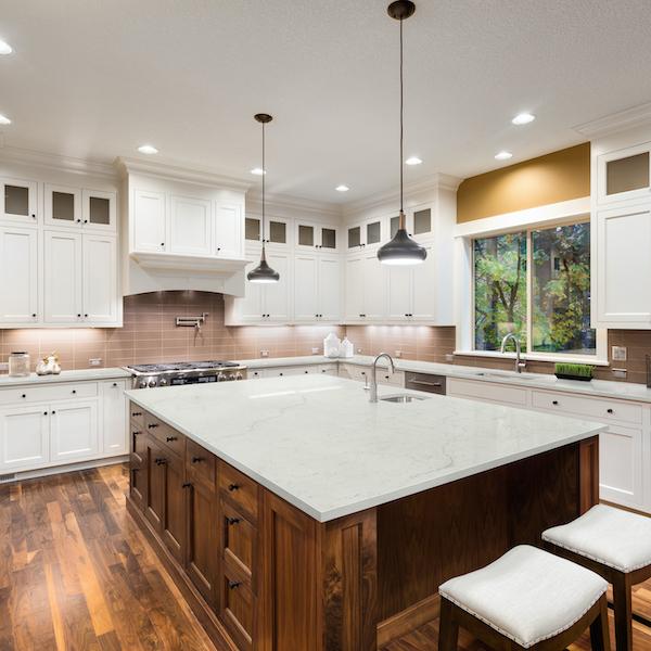 msi-calacatta-lavasa-quartz-white-slab-kitchen-counter-with-wooden-flooring