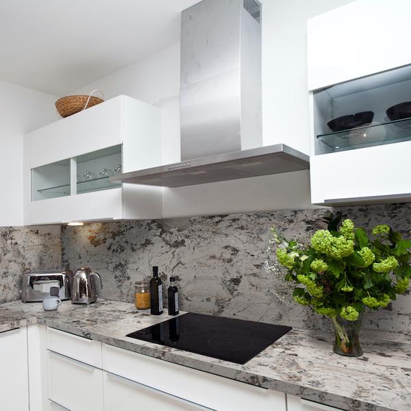 msi-grey-nuevo-swirled-white-granite-counter-with-modern-white-cabinets