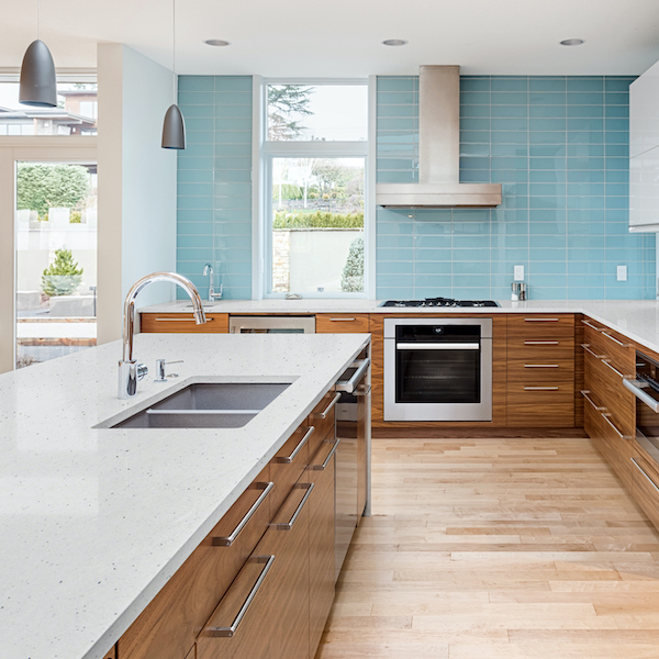 msi-pitaya-white-speckled-granite-in-open-kitchen-with-blue-glass-subway-tile