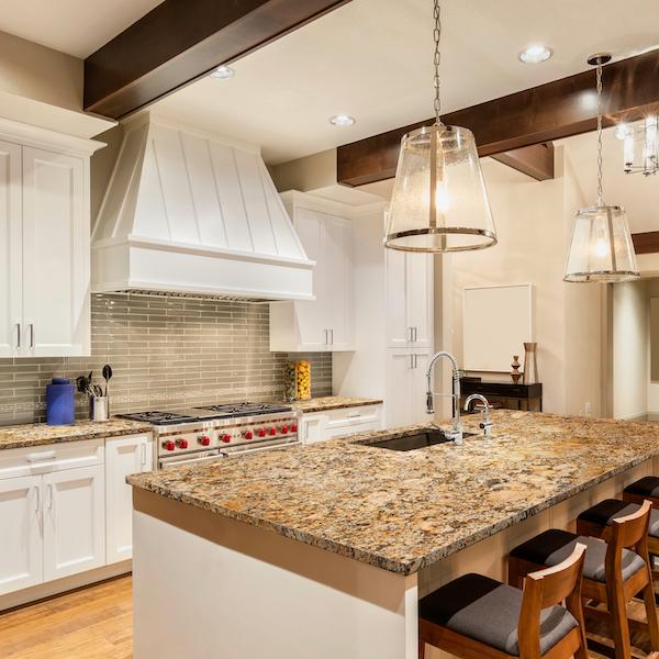 msi-solarius-golden-granite-slab-with-white-cabinets-in-minimalist-country-kitchen