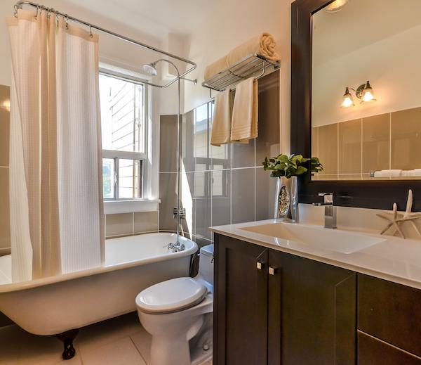 houzz-colonial-white-granite-hotel-vanity-top-in-cream-and-dark-wood-bathroom
