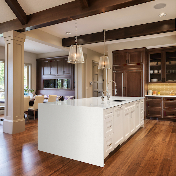 msi-frost-white-thin-slab-quartz-counter-with-waterfall-edge-and-dark-wood-cabinets