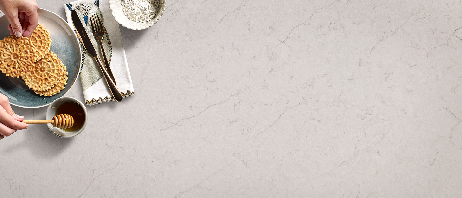 Carrara Caldia Quartz Countertops Vignette