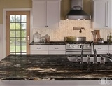 Titanium Granite_Crema Arched Herringbone Polished A