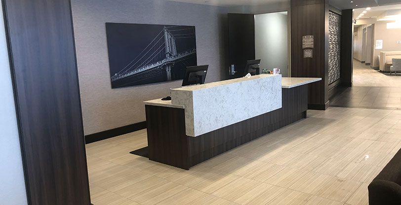 Flooring and countertops in hotel reception area Pelican White Room Scene