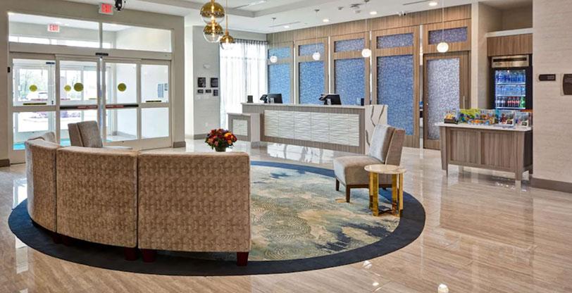 Hospitality flooring in hotel lobby Pietra Venata White Room Scene